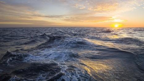 Golden sunrise clouds and rising sun above sea , Atlantic Ocean